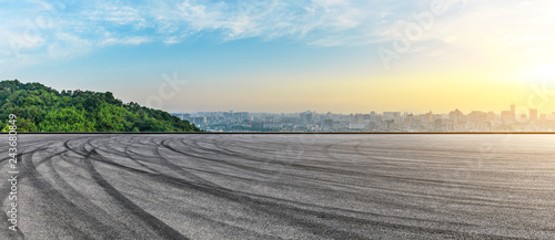 Poster Gris Panoramic city skyline and buildings with empty asphalt road at sunrise