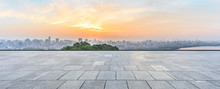Panoramic City Skyline And Buildings With Empty Square Floor At Sunrise