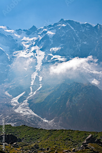 Valokuva  Panoramic view of the imposing east face of Monte Rosa against the light, above Macugnaga in Piedmont, Italy
