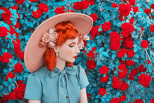 Valentines Day Background. Spring Blooming Rose Flower Garden. Perfect Lady With Red Lips In Dress. Summer Hat. Perfect Flower Wall. Redhead Lady On Background Of Rose Garden. Valentines Postcard
