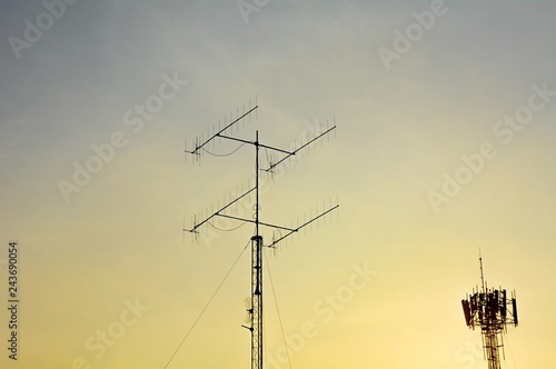 Fotografie, Tablou  televisions antenna and telecommunication tower antenna with sunset background