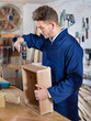 Male worker finishing to drill drawer