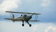 Biplane Flying In Sky