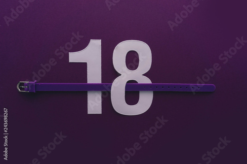 Photographie  18 number eighteen, graphic white digit and creative typography with belt, happy