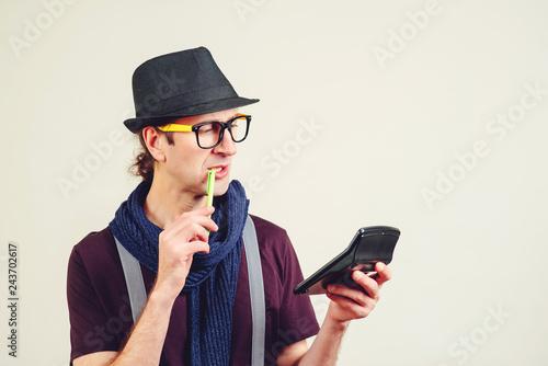 Fotografía  Smart young nerd holding calculator