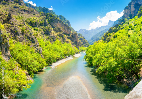 Montage in der Fensternische Olivgrun Panorama of the mountains in Greece from the bridge of Konitsa over Aoos river Zagori. Greece. Europe