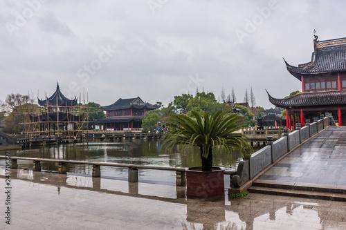 Fotografie, Tablou Confucian temple of Zhouzhuang under the rain, China