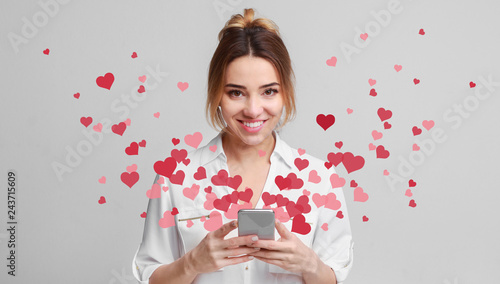 Fényképezés  Love message for Valentine day - hearts flying out smartphone in girls hands