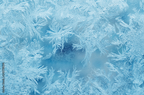 Abstract frosty pattern on glass, background texture Fototapeta