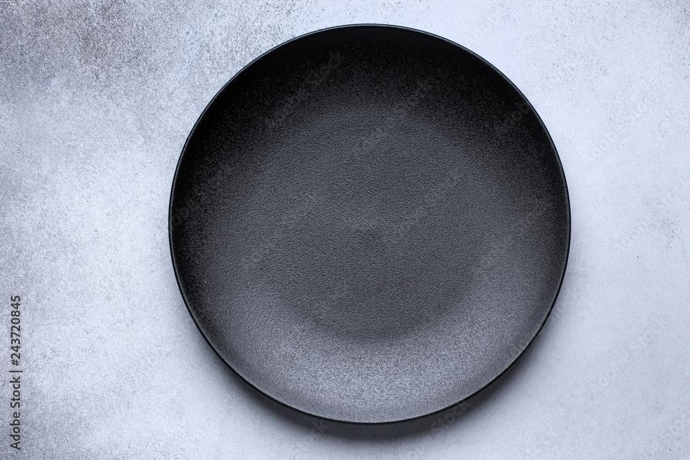 Fotografie, Obraz Empty black plate on gray concrete background
