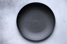 Empty Black Plate On Gray Conc...