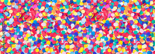 Deurstickers Carnaval Colorful, round confetti as background for carnival, New Year's Eve, banner