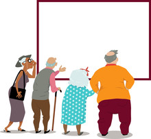 Senior Citizens Looking At A P...