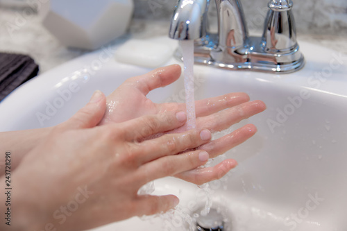 Fotografía  Young Caucasian Female Hands Lathering White Bar Hand Soap for Washing and Perso