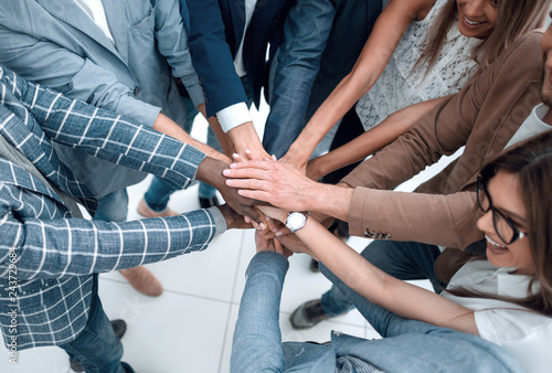 Vászonkép close up.Business people holding hands in a circle