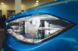 Macro view of modern blue car xenon lamp headlight.