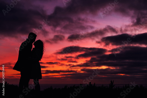 Fototapety, obrazy: evening sky with an orange hue and dark clouds and the silhouett