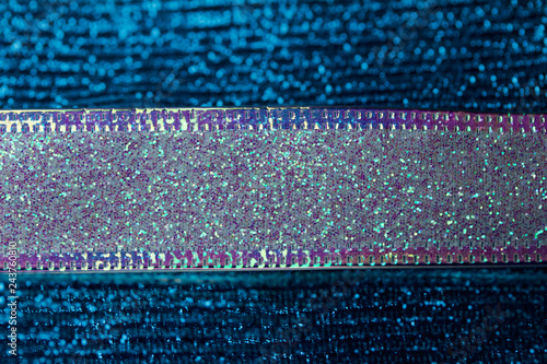 Vibrant blue and pink metallic ribbon macro abstract background with bokeh