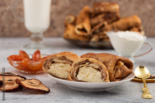 Fotografie, Obraz  Roll made of pancake with filling