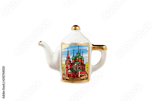 Fotografia  ceramic souvenir toy in the form of kettle with color painting on isolated white