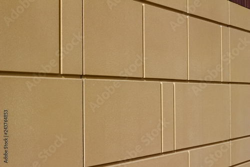 Fotografie, Obraz  Modern brown color stone wall background with geometric shape blocks (angle view