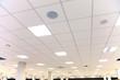 Leinwandbild Motiv White office ceiling with white tiles and lighting
