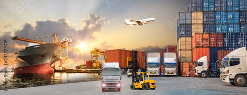 Logistics and transportaIndustrial Container Cargo freight ship, forklift handling container box loading for logistic import export and transport industry concept backgroundtransport industry