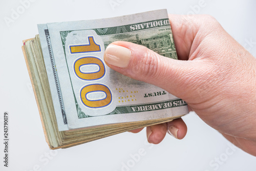 Fotografia, Obraz  Female holding dollar bills Isolated on white background