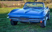 Vintage, Classic Sports Car Convertible Parked By Texas Countryside Pasture With Livestock At Sunset