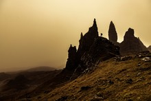 Rock Old Man Of Storr Backlit With Photographer On Rock, Portree, Isle Of Sky, Scotland, United Kingdom, Europe