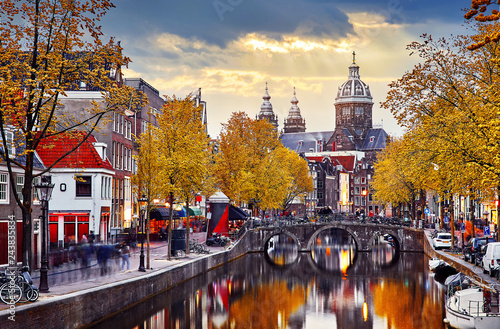 Fototapeta  Amsterdam, Netherlands. Autumn sunset in Red-light district.