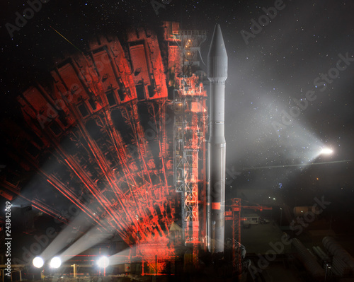 Missile launch preparation prelaunch at night, illumination from spotlights and Illusion of multiple rocker arms. The elements of this image furnished by NASA. Wall mural