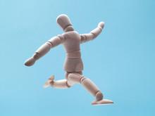 Man Jumping On Blue Sky Backgr...