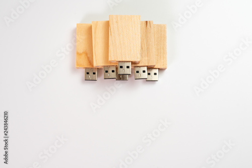 Fotografía  Stack of wooden pendrive memory usb isolated on white background.