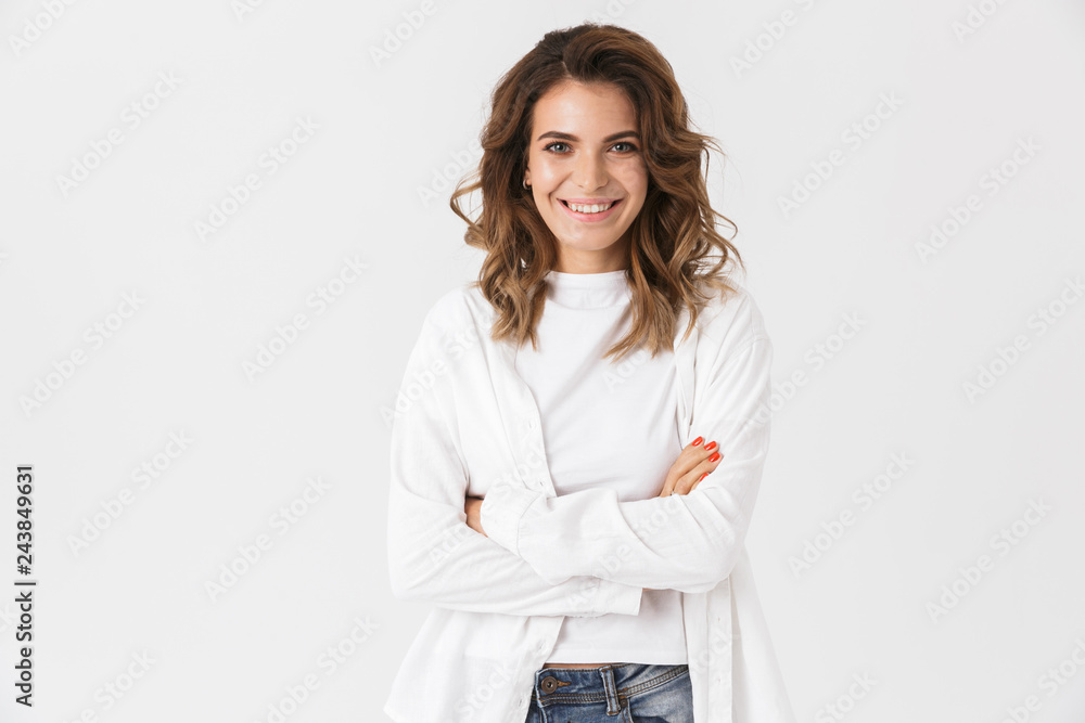 Fototapeta Portrait of smiling woman 30s in casual clothes standing, isolated over white background