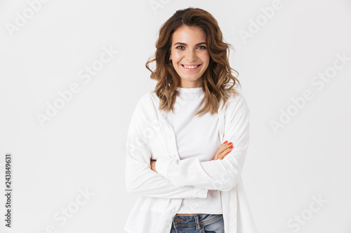 Photo  Portrait of smiling woman 30s in casual clothes standing, isolated over white ba