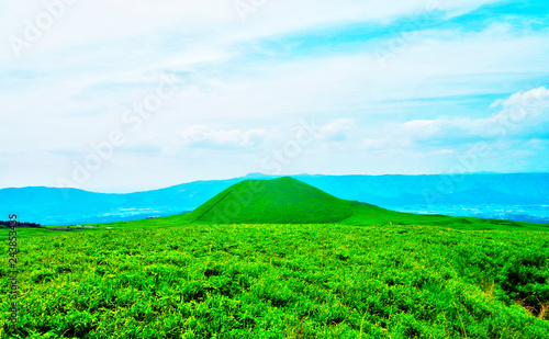 Komezuka scenic spot is small beautiful volcanic cone with natural landscape view ,which is inactive crater has green grass field cover surface in Aso Kuju National Park ,Kumamoto ,Kyushu ,Japan Canvas Print