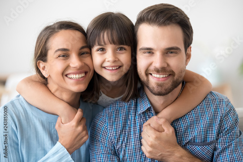 Happy beautiful family of three dad mom and little cute