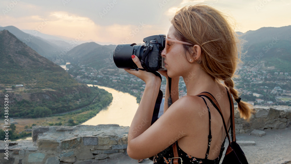 Fototapety, obrazy: Female photographer, taking pictures of mountain landscape at sunset