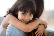 Adorable Little Daughter Hugging Mother Looking At Camera, Mum And Happy Cute Girl Cuddling, Smiling Sincere Child Embracing Mommy, Childrens Day, Adoption, Sweet Kids Love For Mom Concept, Portrait