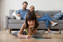 Cute Kid Girl Playing On Warm Floor At Home, Preschool Little Girl Drawing With Colored Pencils On Paper Spending Time With Family In Living Room, Creative Child Activity, Underfloor Heating Concept