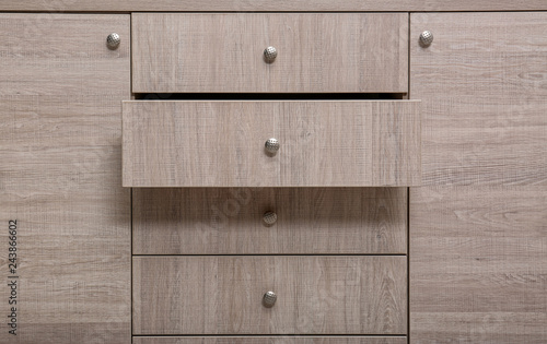 Wooden wardrobe drawers as background, closeup view