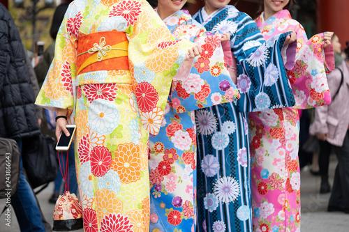 Fototapeta Young girl wearing Japanese kimono standing in front of Sensoji Temple in Tokyo, Japan