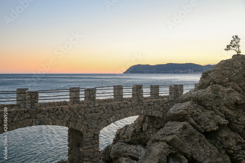 Foto op Aluminium Liguria Scenic view at sunset of the coast of the Ligurian Sea from the cliff of Punta Santa Croce with Capo Mele on the horizon, Alassio, Liguria, Italy
