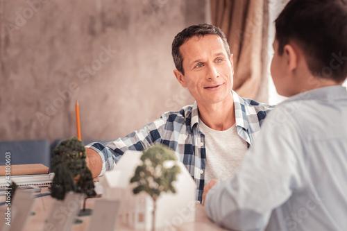 Vászonkép Handsome stylish man talking to his nephew