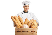 Young Male Baker Holding A Box With Different Types Of Bread