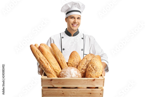 Young male baker holding a box with different types of bread Poster Mural XXL