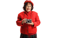 Smiling Old Lady With A Vintage Camera