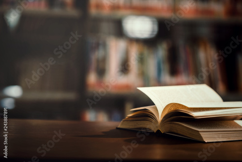 Photo  Book in library with open textbook,education learning concept