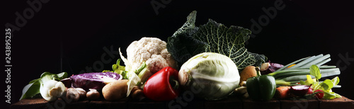 Foto op Plexiglas Verse groenten Composition with variety of raw organic vegetables and fruits. Balanced diet